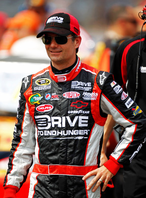 INDIANAPOLIS, IN - JULY 30:  Jeff Gordon, driver of the #24 Drive to End Hunger Chevrolet, stands on the grid during qualifying for the NASCAR Sprint Cup Series Brickyard 400 at Indianapolis Motor Speedway on July 30, 2011 in Indianapolis, Indiana.  (Phot