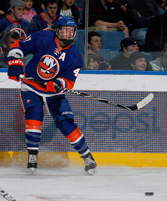 UNIONDALE, NY - MARCH 24:  Andrew MacDonald #47 of the New York Islanders passes the puck during an NHL hockey game against the Atlanta Thrashers at the Nassau Coliseum on March 24, 2011 in Uniondale, New York.  (Photo by Paul Bereswill/Getty Images)