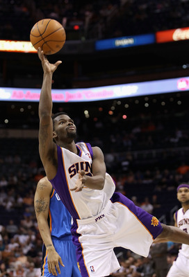 PHOENIX, AZ - MARCH 30:  Aaron Brooks #0 of the Phoenix Suns puts up a shot against the Oklahoma City Thunder during the NBA game at US Airways Center on March 30, 2011 in Phoenix, Arizona.  The Thunder defeated the Suns 116-98. NOTE TO USER: User express