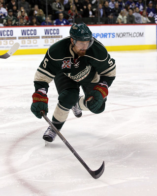 ST PAUL, MN - MARCH 22: Greg Zanon #5 of the Minnesota Wild skates against the Toronto Maple Leafs at the Xcel Energy Center on March 22, 2011 in St Paul, Minnesota.  (Photo by Bruce Bennett/Getty Images)
