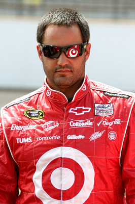 INDIANAPOLIS, IN - JULY 30:  Juan Pablo Montoya, driver of the #42 Target Chevrolet, walks on the grid during qualifying for the NASCAR Sprint Cup Series Brickyard 400 at Indianapolis Motor Speedway on July 30, 2011 in Indianapolis, Indiana.  (Photo by Je