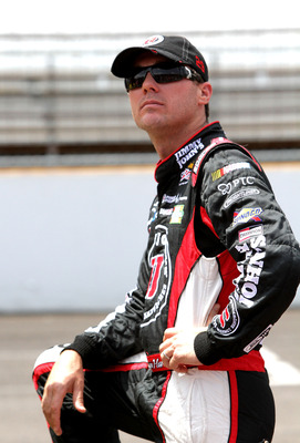 INDIANAPOLIS, IN - JULY 30:  Kevin Harvick, driver of the #29 Jimmy John's Gourmet Sandwiches Chevrolet, stands on the grid during qualifying for the NASCAR Sprint Cup Series Brickyard 400 at Indianapolis Motor Speedway on July 30, 2011 in Indianapolis, I