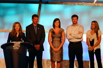 CHARLOTTE, NC - MAY 23: (L-R) Teresa Earnhardt speaks as Kerry Earnhardt, Kelley Earnhardt Elledge, Dale Earnhardt Jr. and Taylor Earnhardt stand on stage as Dale Earnhardt Sr. gets inducted into the 2010 NASCAR Hall of Fame Induction Ceremony at the Char