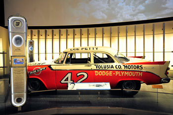 CHARLOTTE, NC - MAY 24: The #42 Plymouth belonging to NASCAR Hall of Fame member Lee Petty is displayed,  during the Hall of Honor unveiling at the NASCAR Hall of Fame on May 24, 2011 in Charlotte, North Carolina. (Photo by Jason Smith/ Getty Images for N