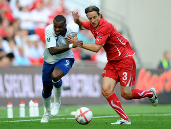 LONDON, ENGLAND - JUNE 04:  Darren Bent of England in action against Reto Ziegler of Switzerland (R) during the UEFA EURO 2012 group G qualifying match between England and Switzerland at Wembley Stadium on June 4, 2011 in London, England.  (Photo by Clive