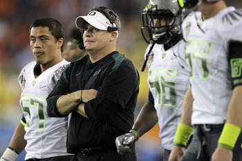 GLENDALE, AZ - JANUARY 10:  Head coach Chip Kelly of the Oregon Ducks looks on against the Auburn Tigers in the Tostitos BCS National Championship Game at University of Phoenix Stadium on January 10, 2011 in Glendale, Arizona.  (Photo by Ronald Martinez/G