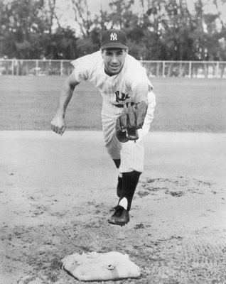 1951:  Phil Rizzuto #10 of the New York Yankees poses for an action portrait circa 1951.  (Photo by Bruce Bennett Studios/Getty Images)