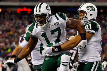 FOXBORO, MA - JANUARY 16:  Braylon Edwards #17 celebrates with Dustin Keller #81 of the New York Jets after Edwards scored a second quarter touchdown during their 2011 AFC divisional playoff game against the New England Patriots at Gillette Stadium on Jan