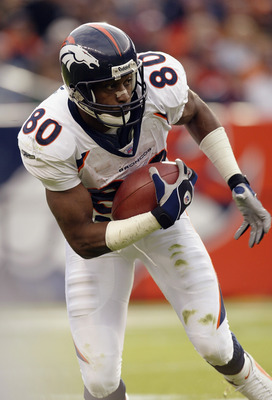 DENVER - NOVEMBER 16:  Wide receiver Rod Smith #80 of the Denver Broncos carries the ball against the San Diego Chargers during the game at Invesco Field at Mile High on November 16, 2003 in Denver, Colorado.  The Broncos won 37-8.  (Photo by Brian Bahr/G
