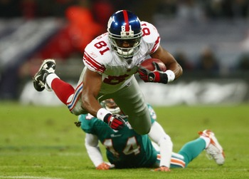 LONDON - OCTOBER 28:  Amani Toomer #81 of the Giants is tap tackled by Cameron Worrell #44 of the Dolphins during the NFL Bridgestone International Series match between New York Giants and  Miami Dolphins at Wembley Stadium on October 28, 2007 in London,