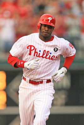 PHILADELPHIA - JUNE 10: Right fielder Domonic Brown #9 of the Philadelphia Phillies rounds the bases after hitting a home run during a game against the Chicago Cubs at Citizens Bank Park on June 10, 2011 in Philadelphia, Pennsylvania. (Photo by Hunter Mar