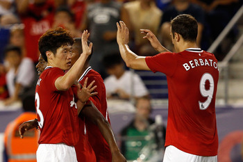 HARRISON, NJ - JULY 27:  Ji-Sung Park #13 of the Manchester United celebrates his goal in the forty-fifth minute with teammate Dimitar Berbatov #9 against the MLS All-Stars during the MLS All-Star Game at Red Bull Arena on July 27, 2011 in Harrison, New J