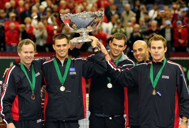 PORTLAND, OR - DECEMBER 02:  Team USA, (L-R) Captain Patrick McEnroe, Mike Bryan, Bob Bryan, James Blake and Andy Roddick, hoist the Davis Cup trophy after defeating Russia 4-1 during the final day of  the Davis Cup Final at the Memorial Coliseum on Decem