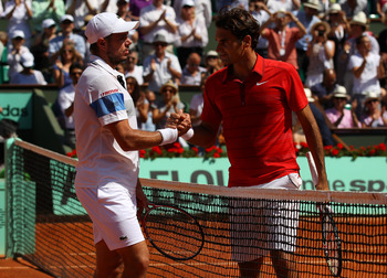 PARIS, FRANCE - MAY 29:  Roger Federer of Switzerland shakes hands at the net with Stanislas Wawrinka of Switzerland after their men's singles round four match on day eight of the French Open at Roland Garros on May 29, 2011 in Paris, France.  (Photo by A