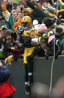GREEN BAY, WI - NOVEMBER 30:  Donald Driver #80 of the Green Bay Packers performs a 'Lambeau Leap' as he celebrates with fans after scoring a 6-yard touchdown reception in the second quarter against the Carolina Panthers at Lambeau Field on November 30, 2