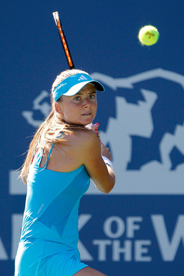 STANFORD, CA - JULY 26:  Daniela Hantuchova of Slovakia returns a shot to Rika Fujiwara in the second set during the Bank of the West Classic at the Taube Family Tennis Stadium on July 26, 2011 in Stanford, California.  (Photo by Matthew Stockman/Getty Im