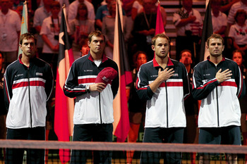 AUSTIN, TX - JULY 08:  Members of the USA team (L to R)  Mike Bryan, Bob Bryan, Andy Roddick and Mardy Fish stand for the National Anthem before the Davis Cup tie between the USA and Spain at the Frank Erwin Center on July 8, 2011 in Austin, Texas.  (Phot