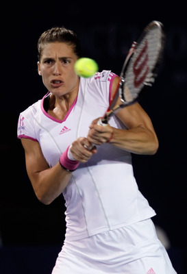 CARLSBAD, CA - AUGUST 02:  Andrea Petkovic of Germany returns a backhand to Alexa Glatch during the Mercury Insurance Open presented by Tri-City Medical at the La Costa Resort and Spa on August 2, 2011 in Carlsbad, California.  (Photo by Jeff Gross/Getty