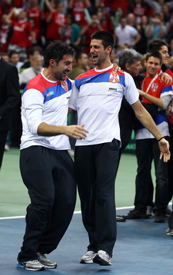 BELGRADE, SERBIA - DECEMBER 05:  Novak Djokovic and Nenad Zimonjic of Serbia celebrate their teams victory over France during day three of the Davis Cup Tennis Final at the Begrade Arena on December 5, 2010 in Belgrade, Serbia.  (Photo by Julian Finney/Ge