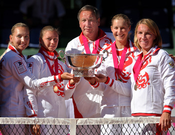 MADRID, SPAIN - SEPTEMBER 14:  The Russian Fed Cup team (L-R) Elena Vesnina, Vera Zvonareva, captain Shamil Tarpische, Ekaterina Makarova and Svetlana Kuznetsova pose with the Fed Cup trophy on day two of the Fed Cup by BNP Paribas World Group Final betwe