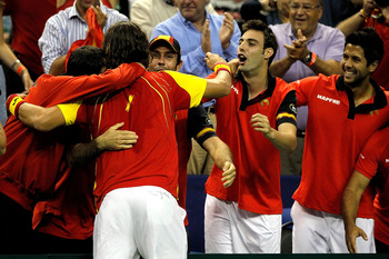 AUSTIN, TX - JULY 08:  Feliciano Lopez of Spain is congratulated by his teammates after defeating Mardy Fish in their tie during the Davis Cup between USA and Spain at the Frank Erwin Center on July 8, 2011 in Austin, Texas.  (Photo by Matthew Stockman/Ge