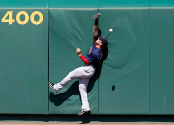 BRADENTON, FL - MARCH 13:  Outfielder Ryan Kalish #55 of the Boston Red Sox cannot come up with this fly ball from the Pittsburgh Pirates during a Grapefruit League Spring Training Game at McKechnie Field on March 13, 2011 in Bradenton, Florida.  (Photo b
