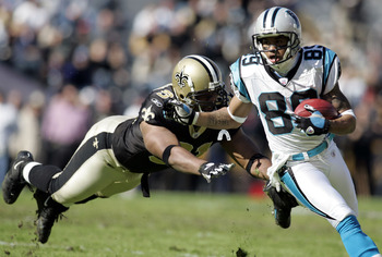 BATON ROUGE, LA - DECEMBER 18: Steve Smith #89 of the Carolina Panthers avoids a tackle by Will Smith #91 of the New Orleans Saints on his way to scoring a touchdown in the first quarter on December 18, 2005 at Tiger Stadium in Baton Rouge, Louisiana.