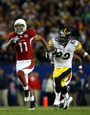 TAMPA, FL - FEBRUARY 01:  Larry Fitzgerald #11 of the Arizona Cardinals runs for a touchdown after a catch against James Harrison #92 of the Pittsburgh Steelers in the fourth quarter during Super Bowl XLIII on February 1, 2009 at Raymond James Stadium in