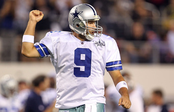 ARLINGTON, TX - OCTOBER 25:  Quarterback Tony Romo #9 of the Dallas Cowboys celebrates a touchdown by Jason Witten against the New York Giants in the first quarter at Cowboys Stadium on October 25, 2010 in Arlington, Texas.  (Photo by Ronald Martinez/Gett