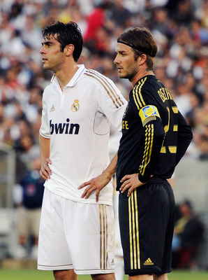 LOS ANGELES, CA - JULY 16:  Kaka #7 of Real Madrid  and David Beckham #23 of  Los Angeles Galaxy during the Herbalife World Challenge 2011 friendly soccer game at Los Angeles Memorial Coliseum on July 16, 2011 in Los Angeles, California.  (Photo by Kevork