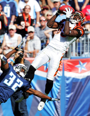 NASHVILLE,TN - OCTOBER 16:   Chad Johnson #85 of the Cincinnnati Bengals catches a touchdown pass while defended by Pacman Jones #32 of the Tennessee Titans on October 16, 2005 in Nashville, Tennessee. The Bengals beat the Tennessee Titans 31-23.   (Photo