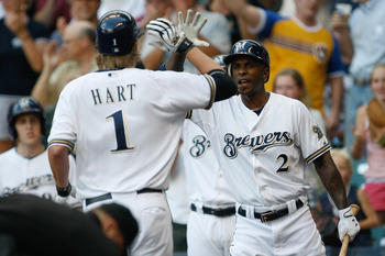 MILWAUKEE, WI - JULY 30: Corey Hart #1 of the Milwaukee Brewers is congratulated by Nyjer Morgan #2 after hitting a home run against the Houston Astros at Miller Park on July 30, 2011 in Milwaukee, Wisconsin. (Photo by Scott Boehm/Getty Images)