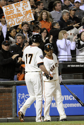 SAN FRANCISCO, CA - AUGUST 1: Aubrey Huff #17 of the San Francisco Giants celebrates with Orlando Cabrera #43 after hitting a home run against the Arizona Diamondbacks in the seventh inning during a MLB baseball game at AT&T Park August 1, 2011 in San Fra