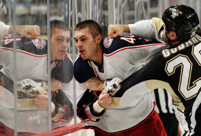 PITTSBURGH, PA - FEBRUARY 8:  Jared Boll #40 of the Columbus Blue Jackets takes a punch from Eric Godard #28 of the Pittsburgh Penguins during a third period fight on February 8, 2011 at CONSOL Energy Center in Pittsburgh, Pennsylvania.  (Photo by Jamie S