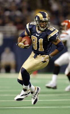 ST. LOUIS - DECEMBER 21:  Wide receiver Torry Holt #81 of the St. Louis Rams carries the ball during the game against the Cincinnati Bengals on December 21, 2003 at the Edward Jones Dome in St. Louis, Missouri. The Rams defeated the Bengals 27-10. (Photo