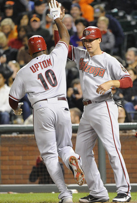 SAN FRANCISCO, CA - AUGUST 2: Justin Upton #10 of the Arizona Diamondbacks after hitting a two-run home run celebrates with Kelly Johnson #2 against the San Francisco Giants in the eighth inning  during an MLB baseball game at AT&T Park August 2, 2011 in