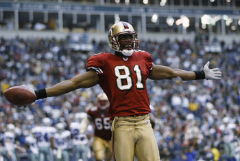 IRVING, TX - DECEMBER 8:  Wide receiver Terrell Owens #81 of the San Francisco 49ers celebrates in the end zone after scoring a touchdown against the Dallas Cowboys with 12 seconds left on December 8, 2002 at Texas Stadium in Irving, Texas.  The 49ers bea
