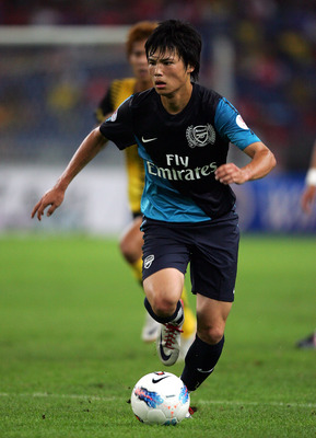 KUALA LUMPUR, MALAYSIA - JULY 13: Ryo Miyaichi of Arsenal dribbles during the pre-season Asian Tour friendly match between Malaysia and Arsenal at Bukit Jalil National Stadium on July 13, 2011 in Kuala Lumpur, Malaysia.  (Photo by Stanley Chou/Getty Image