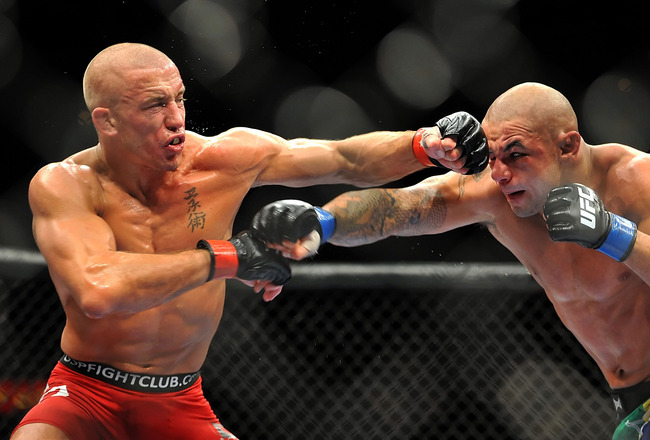 LAS VEGAS - JULY 11:  (L-R) Georges St. Pierre battles Thiago Alves during their welterweight title bout during UFC 100 on July 11, 2009 in Las Vegas, Nevada.  (Photo by Jon Kopaloff/Getty Images)