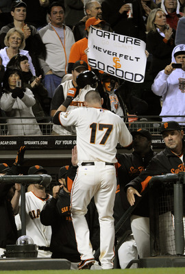 SAN FRANCISCO, CA - AUGUST 1: Aubrey Huff #17 of the San Francisco Giants celebrates after hitting a home run against the Arizona Diamondbacks in the seventh inning during a MLB baseball game at AT&T Park August 1, 2011 in San Francisco, California. The D