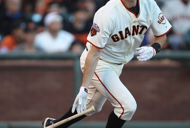 SAN FRANCISCO, CA - JULY 19:  Brandon Belt #9 of the San Francisco Giants hits a solo home run in the second inning against the Los Angeles Dodgers at AT&amp;T Park on July 19, 2011 in San Francisco, California.  (Photo by Jed Jacobsohn/Getty Images)