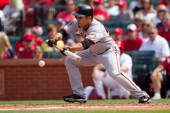 ST. LOUIS, MO - MAY 30: Andres Torres #56 of the San Francisco Giants lays down a sacrifice bunt against the St. Louis Cardinals at Busch Stadium on May 30, 2011 in St. Louis, Missouri.  (Photo by Dilip Vishwanat/Getty Images)