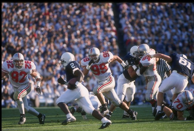 29 Oct 1994:  Defensive lineman Luke Fickell of the Ohio State Buckeyes (right) pursues a Penn State Nittany Lions player during a game at Beaver Stadium in University Park, Pennsylvania.  Penn State won the game, 63-14. Mandatory Credit: Doug Pensinger