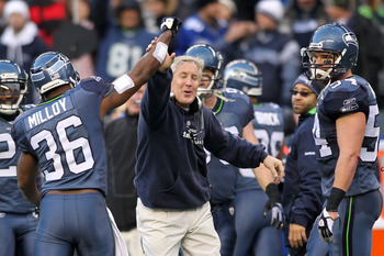 SEATTLE, WA - JANUARY 08: Head coach Pete Carroll and Lawyer Milloy #36 of the Seattle Seahawks celebrate a fourth down stop by the Seahawks in the third quarter against the New Orleans Saints during the 2011 NFC wild-card playoff game at Qwest Field on J