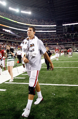 ARLINGTON, TX - SEPTEMBER 05:  Quarterback Sam Bradford #14 of the Oklahoma Sooners walks off the field after a 14-13 loss against the Brigham Young Cougars at Cowboys Stadium on September 5, 2009 in Arlington, Texas.  Bradford suffered an injury in the s