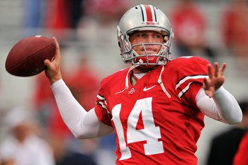 COLUMBUS, OH - SEPTEMBER 26:  Quarterback Joe Bauserman #14 of the Ohio State Buckeyes warms up before a game against the Illinois Fighting Illini at Ohio Stadium on September 26, 2009 in Columbus, Ohio.  (Photo by Jamie Sabau/Getty Images)