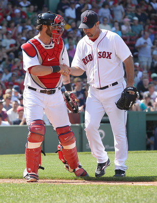 BOSTON, MA  - JULY 24:  Tim Wakefield #49 of the Boston Red Sox is congratulated by Jarrod Saltalamacchia #39 of the Boston Red Sox after Wakefield earned his one thousand strikeout as a pitcher for the Red Sox during a game against the Seattle Mariners a