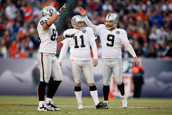 DENVER - DECEMBER 20:  (L-R) Brandon Meyers #83, Sebastian Janikowski #11 and Shane Lechler #9 of the Oakland Raiders celebrate a 54 yard field goal by Janikowski in the second quarter against the Denver Broncos at Invesco Field at Mile High on December 2
