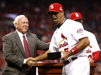 ST. LOUIS, MO - APRIL 3:  General Manager Walt Jocketty presents Albert Pujols #5 of the St. Louis Cardinals with his 2006 World Series Championship ring before playing the New York Mets at Busch Stadium April 3, 2007 in St. Louis, Missouri.  (Photo by Di