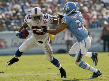 NASHVILLE, TN - NOVEMBER 15:  Fred Jackson #22 of the Buffalo Bills fights to break free from Cortland Finnegan #31 of the Tennessee Titans in their NFL game at LP Field on November 15, 2009 in Nashville, Tennessee.    (Photo by John Sommers II/Getty Imag